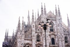 Facade of Milan Cathedral Duomo from the Square Piazza del Duomo, Lombardy, Italy. The largest church in Italy. Image with copy. Space stock photo
