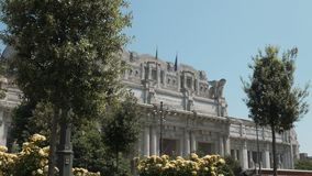 Facade of Milan Central Station with trees and flowers, Milano, Italy.  stock video