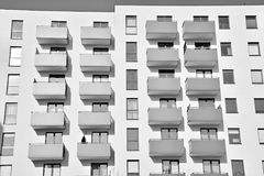Facade of a modern apartment building. Black and white. Modern reential buildings. Facade of new low-energy houses Stock Image