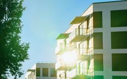 Facade modern apartment house copy space green tree sun light. Facade of modern residential apartment house building. Including place for copy space. And green royalty free stock photos