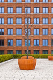 Facade of modern brick building with a tree in front. WIESBADEN, GERMANY - FEB 19, 2011: facade of modern brick building with a tree in front royalty free stock image
