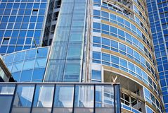 Facade of a modern building. Abstract closeup of the glass-clad facade of a modern building covered in reflective plate glass Royalty Free Stock Photography