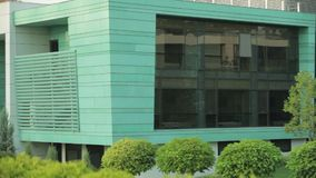 Facade of the modern building, right to left general shot stock footage