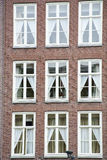 Facade of the modern european house with nine windows and blinds Royalty Free Stock Photo