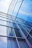 Facade of modern glass blue office and sky Stock Images