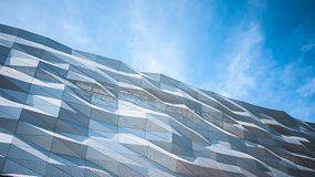 Facade of modern office building. And blue sky background,  blue toned images Stock Photo