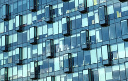 Facade of modern office building glass wall front view. Facade with glass wall of modern office building with many large panoramic windows in business cluster Stock Photos