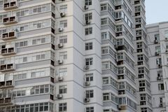 Facade of modern residential high rise building with lots of windows and apartments. Stock image stock image
