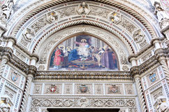 Facade and mosaic of cathedral in Florence, Italy. The Basilica di Santa Maria del Fiore, in english the Basilica of Saint Mary of the Flower, or Duomo, as it is Royalty Free Stock Image
