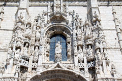 Facade of Mosteiro dos Jeronimos, Belem, Portugal. The Mosteiro dos Jeronimos in Belem, part of Lisbon, and the adjoined church is possibly the most extravagant royalty free stock images