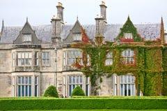 Facade of Muckross House, Killarney, Ireland. Muckross House, County Kerry, Ireland - is a Tudor style mansion built in 1843 located on the small Muckross Stock Photo