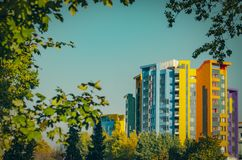 The facade of a multi-storey multi-colored building on the backg royalty free stock photo