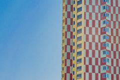The facade of a multi-storey multi-colored residential building stock photography