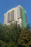 Facade of multistory buildings and green trees Royalty Free Stock Photography