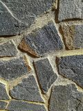 Facade of gray natural stone stock photography