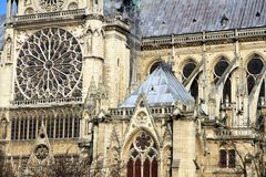 Facade of Notre Dame cathedral in Paris next to the Seine River. Stock Photo