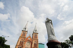 Facade of Notre Dame church with Maria Virgin statue in Saigon, Vietnam Stock Photography