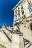 Facade of Nymphenburg castle with bavarian lion and crest Royalty Free Stock Photos