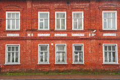 Facade Of Old Red Brick House Stock Image
