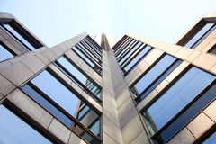 Facade of office building. Facade of marble office building with blue sky reflected Royalty Free Stock Photos