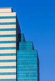 Facade of Office Building in Morning Sunlight. Blue Sky Background Royalty Free Stock Image