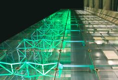 Facade of office building at night Stock Images