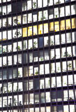 Facade of office building by night Stock Photo