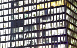 Facade of office building by night Stock Photography