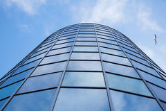 Facade of office building with overcast sky reflected Royalty Free Stock Photos