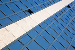 Facade of office building with overcast sky reflected Stock Photography