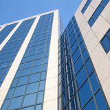 Facade of office building with overcast sky reflected Royalty Free Stock Image