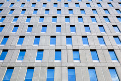 Facade of office building with overcast sky reflected Royalty Free Stock Images