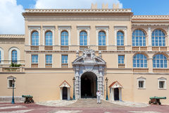 Facade of official residence of Prince of Monaco. MONACO-VILLE, MONACO - JULY 13, 2013: Facade of official residence of Prince of Monaco and security guard at royalty free stock photos