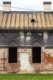 Facade of old abandoned house with dark windows in Slovakia Royalty Free Stock Photo