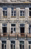 Facade of an old abandoned house in Porto Stock Image