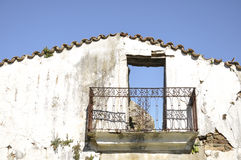 Facade of an old abandoned house Stock Photography