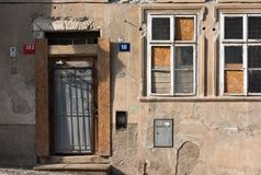 The facade of the old abandoned house. Windows and the input. Arrays stock photos