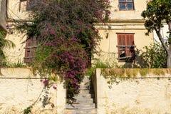 Facade of old abandoned stone house. A facade of old abandoned stone house royalty free stock image