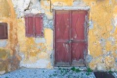 Facade of old abandoned stone house. A facade of old abandoned stone house royalty free stock photography