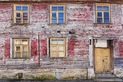 Facade of an old abandoned wooden house Stock Photos