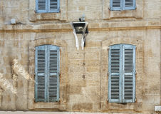 The facade of an old apartment building in the historic center of Avignon Royalty Free Stock Images