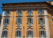 Facade of Old Apartment Building in Rome Stock Image