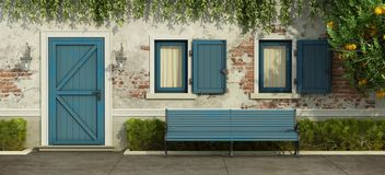 Old house with blue door and windows. Facade with old brick wall,blue door , windows and bench - 3d rendering Royalty Free Stock Photo