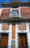 Facade of the Old Building. Building decorated with ornamental tiles called Talavera. Puebla, Mexico Stock Photo