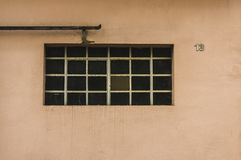 Facade of an old building with metal windows and rungs House num royalty free stock image