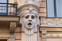 Facade of old building with sculptures - woman heads in Art Nouveau style Jugendstil Stock Images
