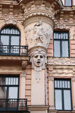 Facade of old building with sculptures - woman heads in Art Nouveau style Jugendstil Royalty Free Stock Image