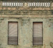 Facade of old building in Spanish town. Facade of old building with two windows and parapet in Spanish town Royalty Free Stock Photography