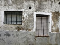 Facade of old building in Spanish town. Facade of old building with two windows in Spanish town Stock Image