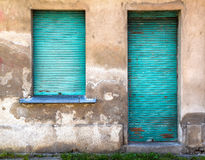 Facade. Of old building with turquoise shutters Stock Image
